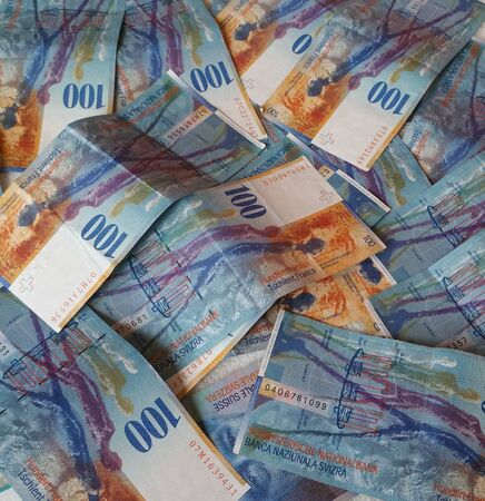 swiss franc note: Cash Swiss Franc lying on the plane