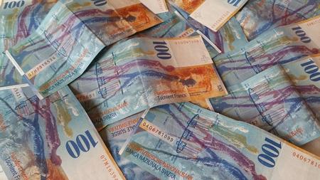 Cash Swiss Franc lying on the plane