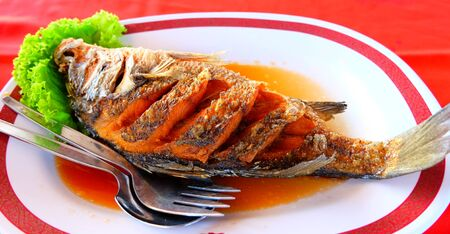 fish sauce: Fried snapper with fish sauce Stock Photo