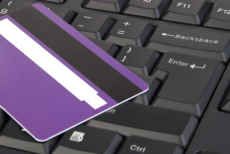 Close-up shot of keyboard and purple credit card