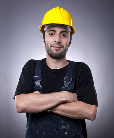 Studio shot of young construction worker with arms crossed Stock Photo