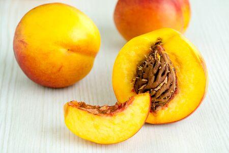 Fresh peaches on white kitchen table - selective focus