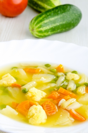 Delicious vegetable soup with various fresh vegetables in it