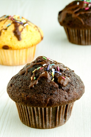 Chocolate muffins on white table - selective focus