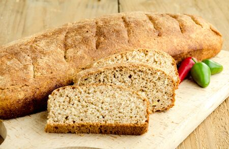Homemade brown bread on rustic  wooden table