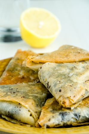 Delicious baklavas, lemon and water - selective focus