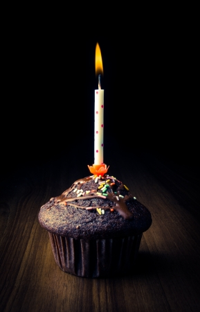 Birthday cupcake with burning candle - low key