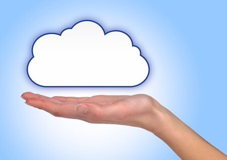 Female hand holding a illustrated cloud on blue background photo