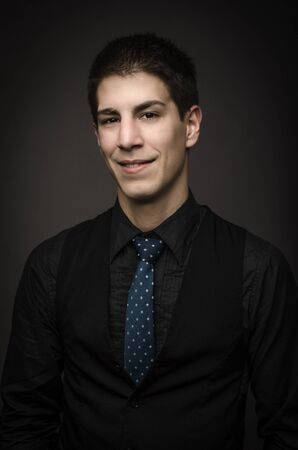 Studio shot of elegant smiling man on dark background Stock Photo