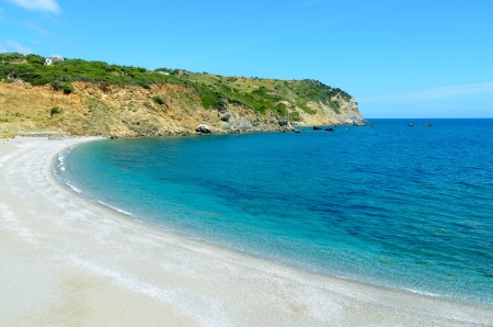 Beautiful wild beach with white sand and turquoise sea