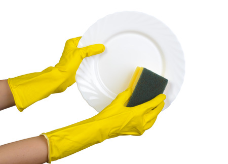 Hands in yellow rubber gloves washing plate isolated on white
