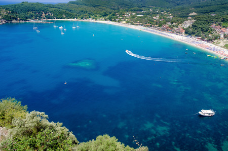 Beautiful aerial view of blue water bay with boats near Valtos beach, Greece