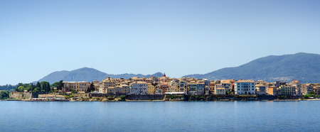 Panoramic skyline view from water of small mediterranean town on Corfu island, Greece
