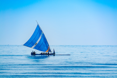 outrigger: A traditional indonesia outrigger canoe converted into a sailing boat for tourists. Editorial