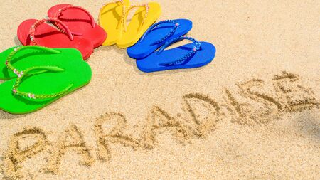 vibrance: Paradise written in the sand and colored sandals spread into semi circle shape
