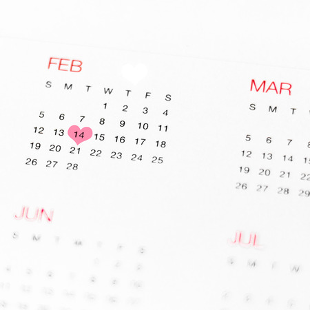 assignation: Calendar with Valentines day love heart on white background. Stock Photo