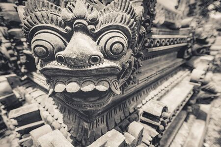 A stone carving of mythical hindu spirit named (Barong), who is believed to be king of the spirits, leader of the hosts of good, and enemy of Rangda in the mythological traditions of Bali