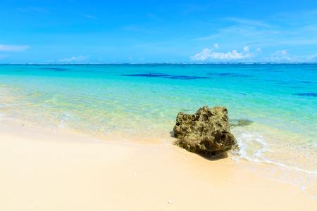 water's edge: A beautiful beach on the tropical Island of Bali, Indonesia. Stock Photo