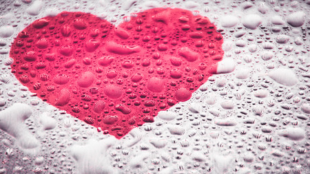 loveheart: Water droplets on tablet screen with loveheart symbol
