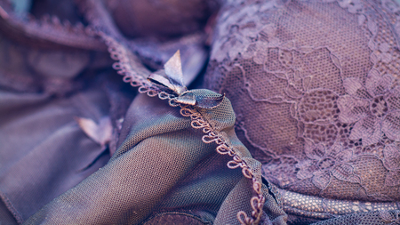 seduction: An abstract closeup of womans lingerie with overall purple tone adding to the feel of romance and seduction. Stock Photo