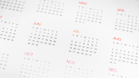 assignation: A calander with the months written in red and the days in black.