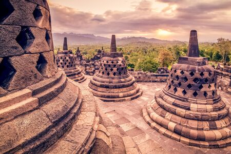 World hertiage site Borobudor situated in the special region of Yogyakarta, Indonesia. It is estimated this site is over 1000 years old. Stock Photo