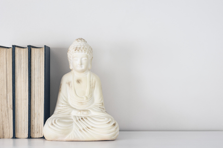 Buddha ornament book stop with copy space.