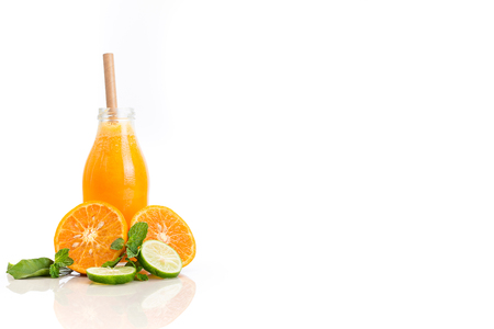 Orange fruit juice isolated on white background with cut fruit and copy space.
