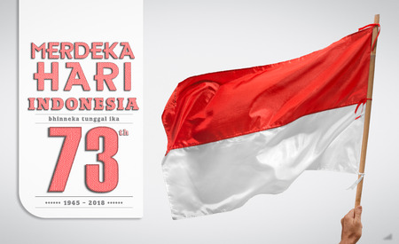 Indonesian independance day  with flag waving over background and indonesian text. Stock Photo