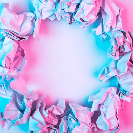 Hot pink and blue abstract square border background image made from crumpled paper with copy space for text. Stockfoto