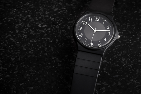 Simple unbranded unisex black analog watch with copy space for text.