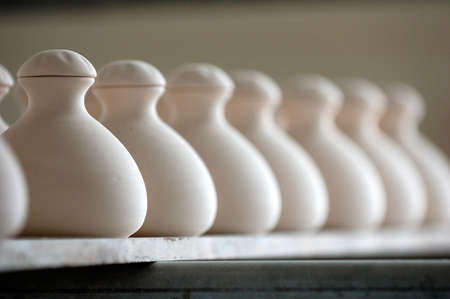 Line of pots with focus on the first pot Stock Photo