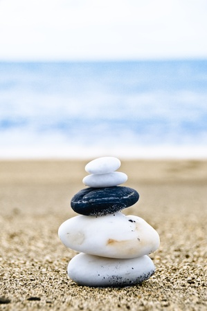 Close up shot of stones balanced on a beach photo