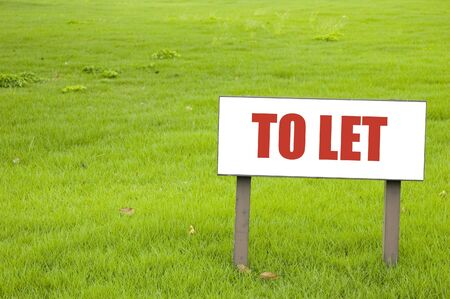 private property: Shot of a to Let board on green grass Stock Photo