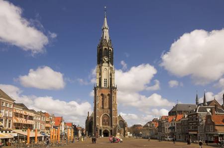 Nieuwe Kerk cathedral in Delft, panorama of the main square Фото со стока