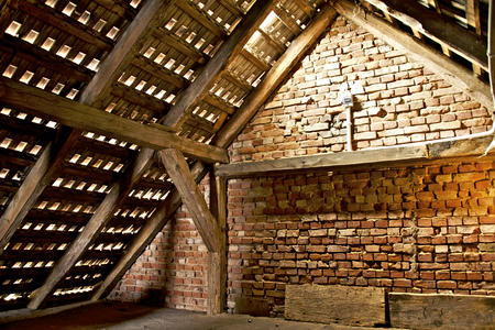 first floor of an old detached country house - red brick wooden beams and cement tiles Фото со стока