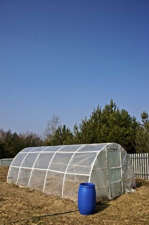 small PVC tunnel greenhouse, part of self-sustainable household