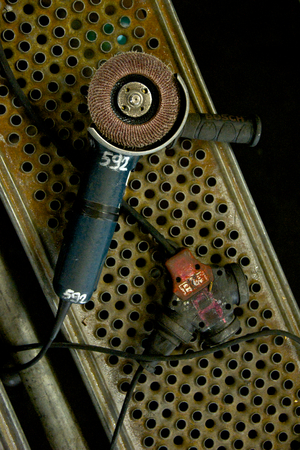 rusty angle grinder, industrial tool in a workshop