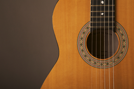 Studio detail photograph of an acoustic spanish classical guitar