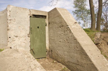 bombed city: Old underground building a bunker from WWII in Westerplatte near Gdansk in Poland. Historical structure and a touristic attraction Stock Photo