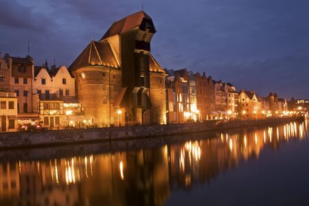 Night panorama of the historical medieval port in Gdansk in Poland. Detail view of the old crane local touristic attraction