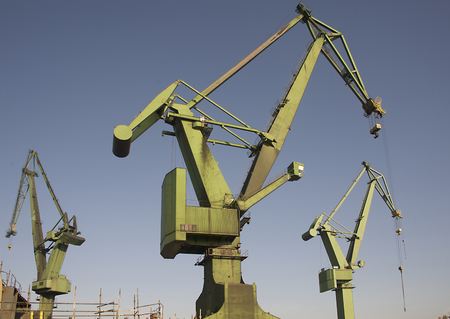 Heavy industrial cranes used for ship construction in the harbor of Gdansk in Poland Фото со стока