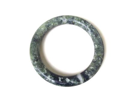 Close up of green jade bracelet isolated on white background. Stock Photo