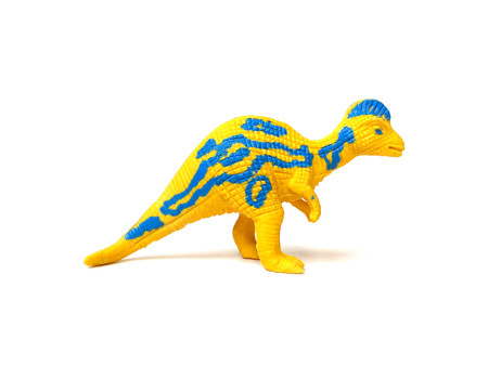 Close up of colorful dinosaur toy isolated on white background. Stock Photo