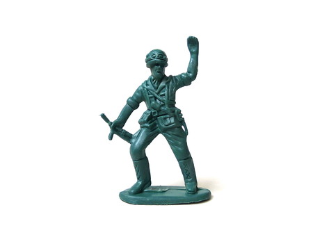 Close up of plastic soldier toy isolated on white background. Imagens