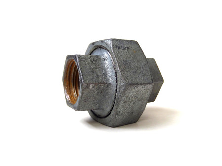 Close up of galvanized steel pipe fitting isolated on white background.