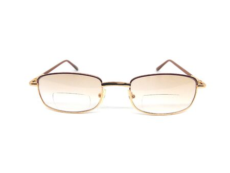 Gold frame eyeglasses with bifocal lens isolated on white background.