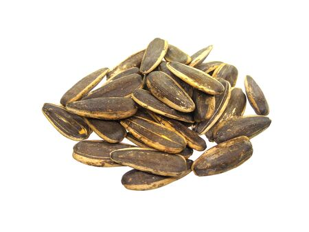 Pile of sunflower seeds isolated on white background.