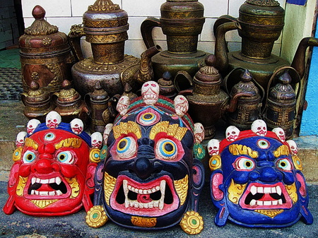 Tibetan Buddhist Deity Masks and Tea Pots Stock Photo