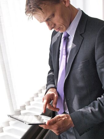 Businessman on tablet pc photo